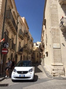 Car in narrow street Ortigia, Siracusa, Sicily